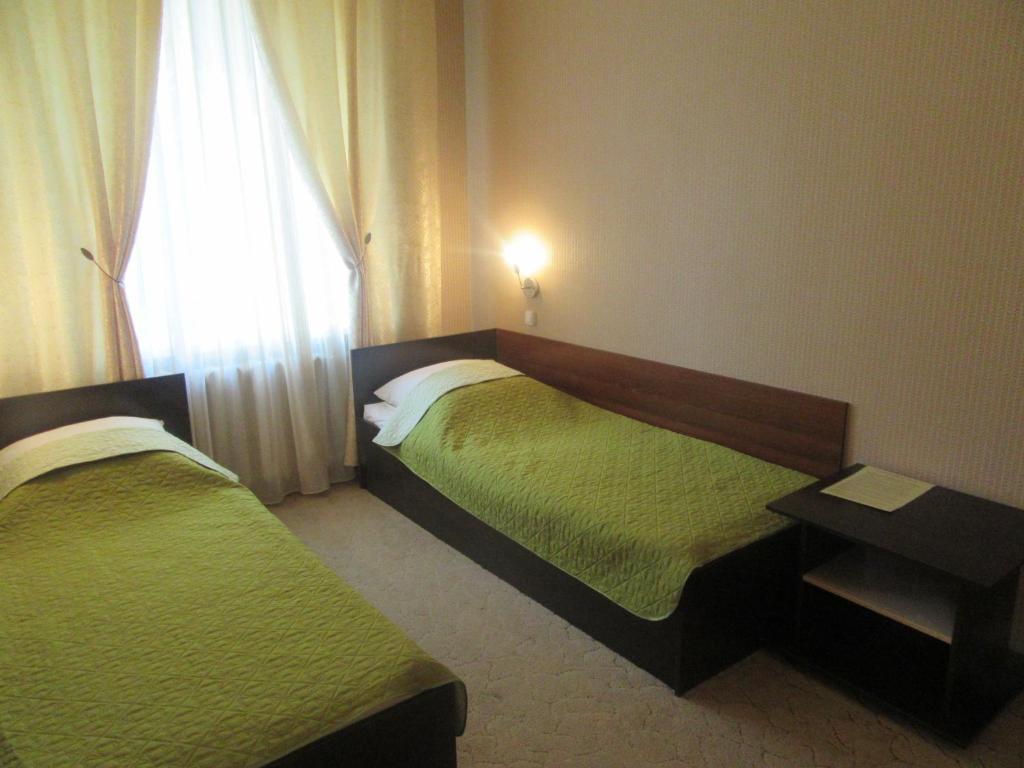 Кровать или кровати в номере Отель Эврика