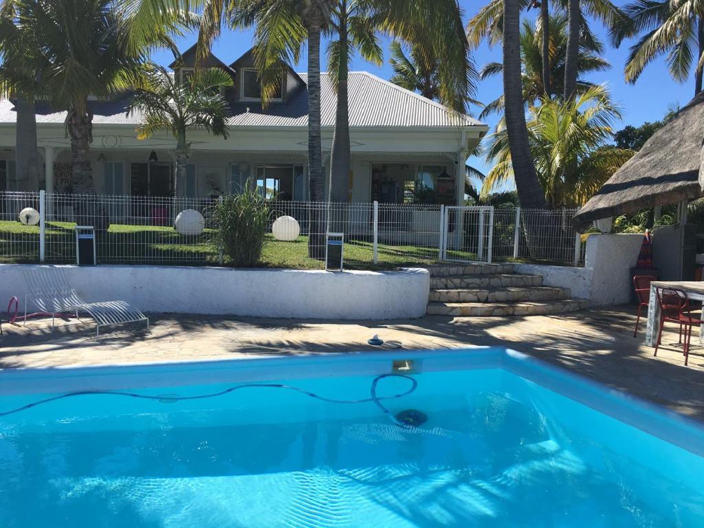 The swimming pool at or near La Villa De Chriss