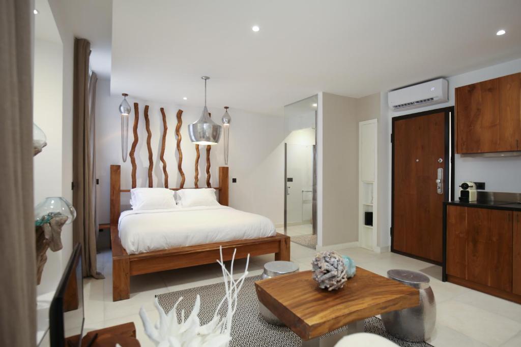 A bed or beds in a room at Magnifiques Appartements à 2 pas du Palais
