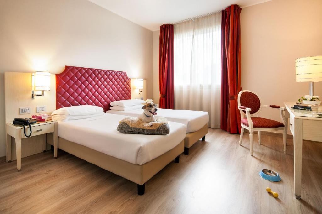 Letto o letti in una camera di Just Hotel Lomazzo Fiera
