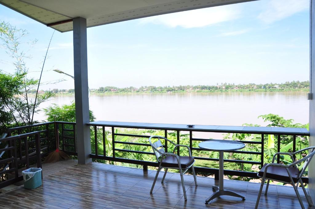 A balcony or terrace at The Rim Riverside Guest House