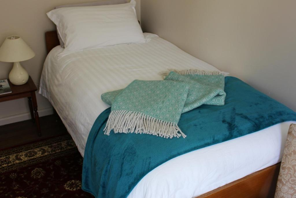 A bed or beds in a room at National Park Hotel
