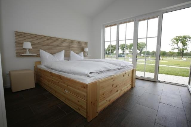 A bed or beds in a room at Havellandhalle Resort