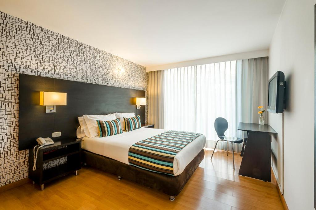 A bed or beds in a room at Hotel L'Etoile Javeriana