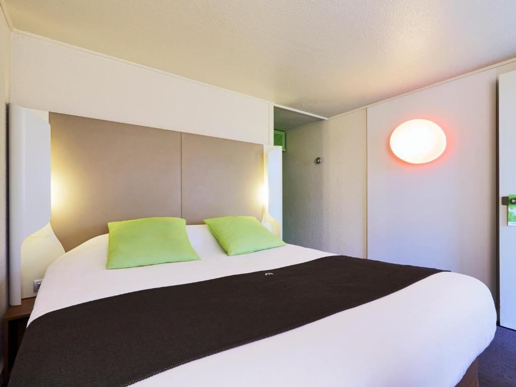 Un ou plusieurs lits dans un hébergement de l'établissement Campanile Dijon Est - Saint Apollinaire
