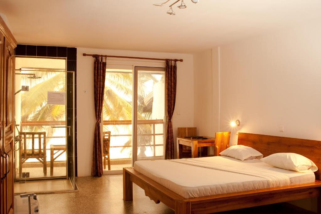 A bed or beds in a room at Oasis Beach Resort