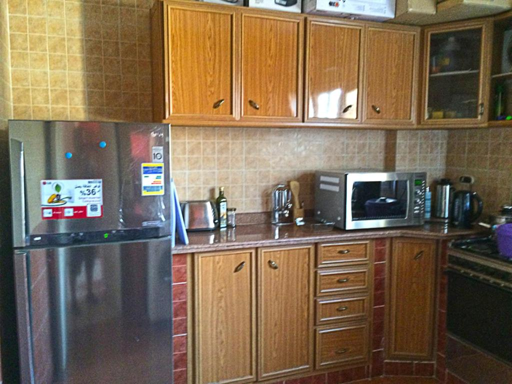 A kitchen or kitchenette at Cairo Guesthouse Rooms