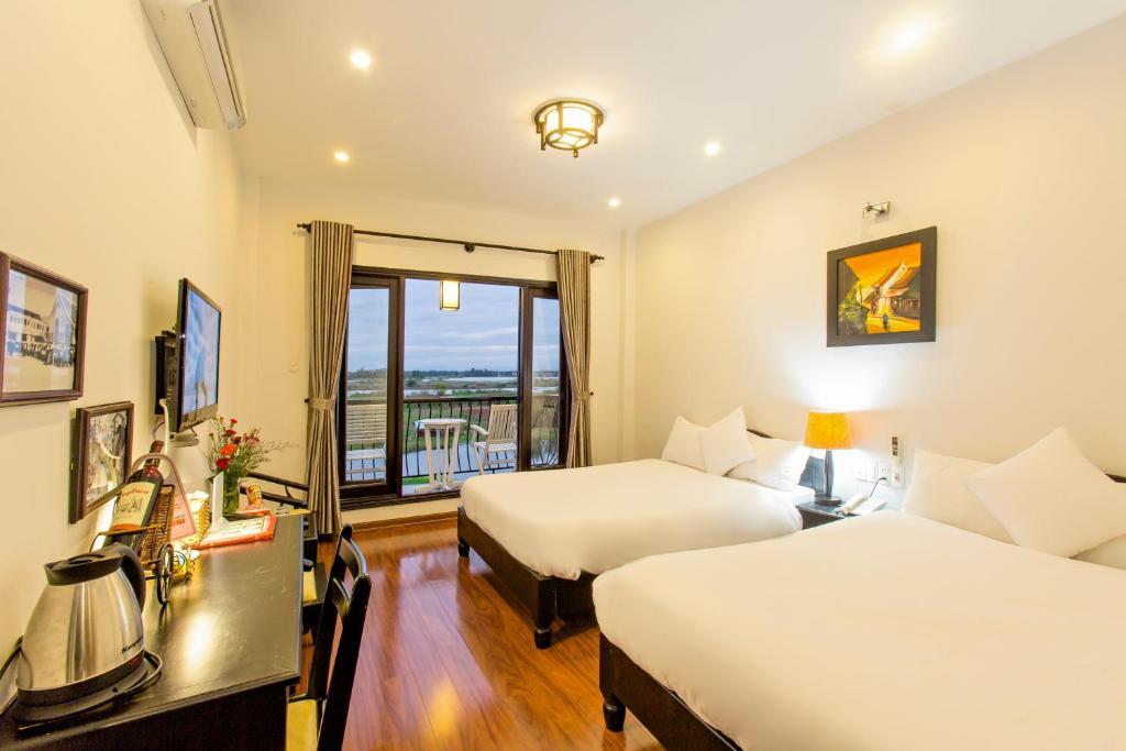 Phòng Deluxe 2 Giường Đơn Nhìn Ra Sông