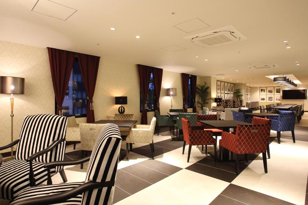 A restaurant or other place to eat at Centurion Hotel Grand Kobe Station