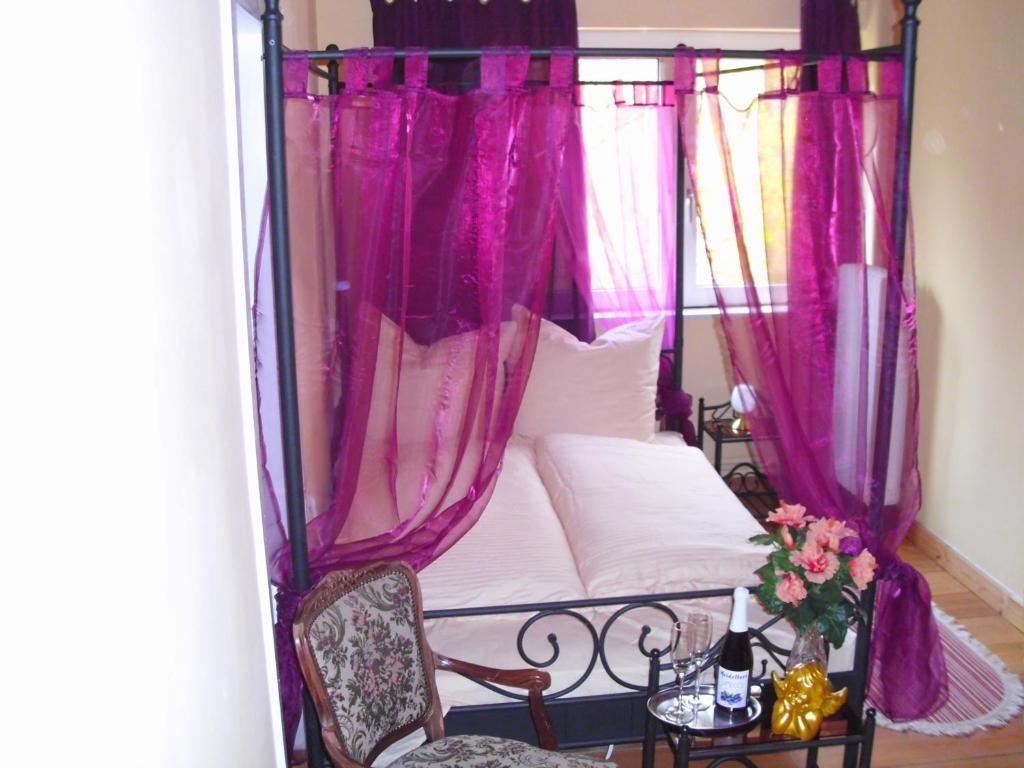 Ein Bett oder Betten in einem Zimmer der Unterkunft Hotel am Stern