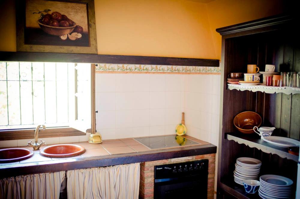 A kitchen or kitchenette at Casa del Huerto