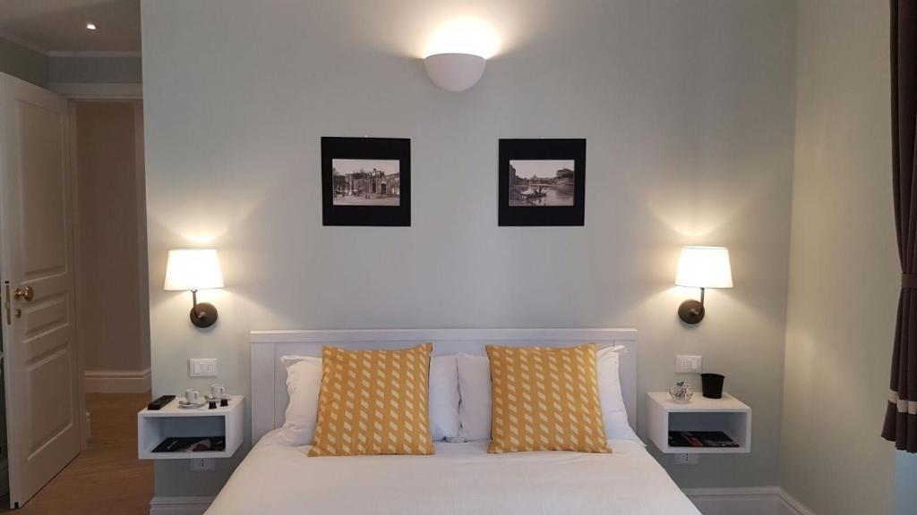 Ліжко або ліжка в номері Roman Suite Guest House