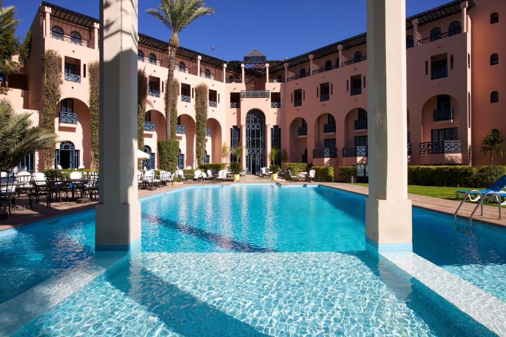 The swimming pool at or near Hotel Marrakech le Tichka