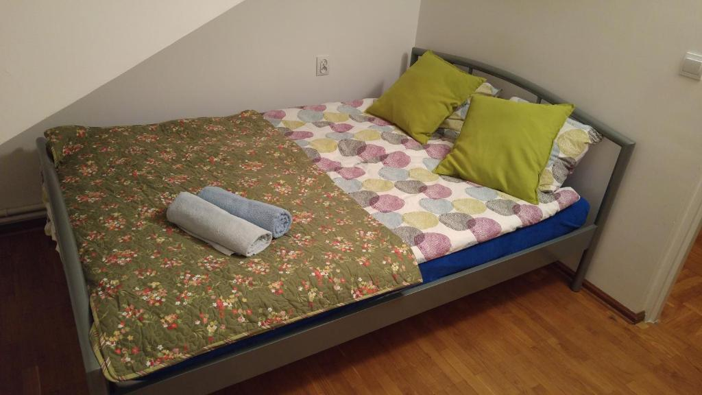 A bed or beds in a room at AdMatch Brwinow Rooms