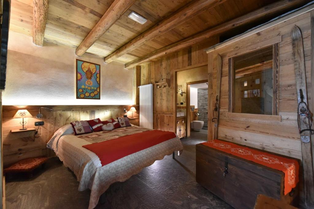 A bed or beds in a room at L'Ancien Paquier Chambre D'Hotes