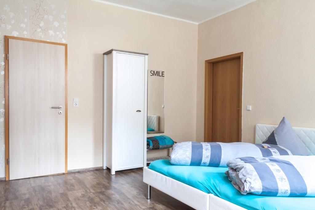 Ein Bett oder Betten in einem Zimmer der Unterkunft Rübezahl