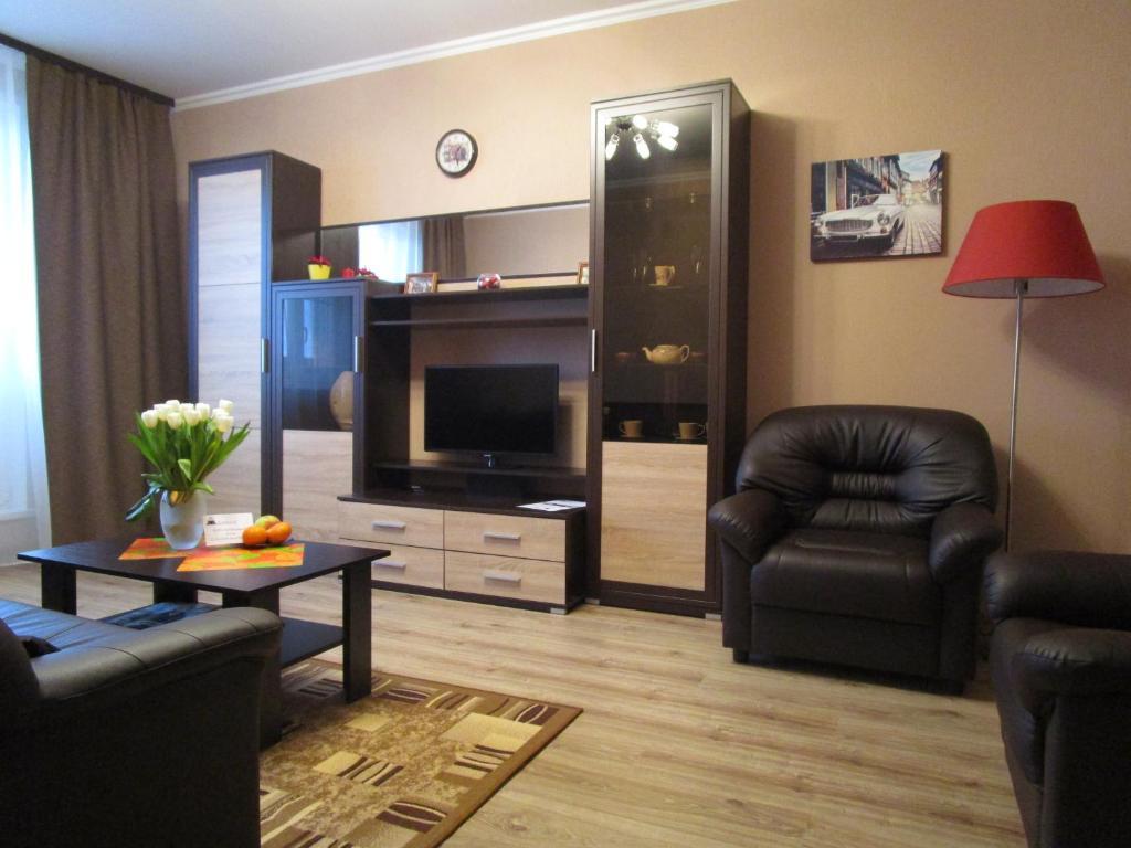 Телевизор и/или развлекательный центр в Caravan apartments