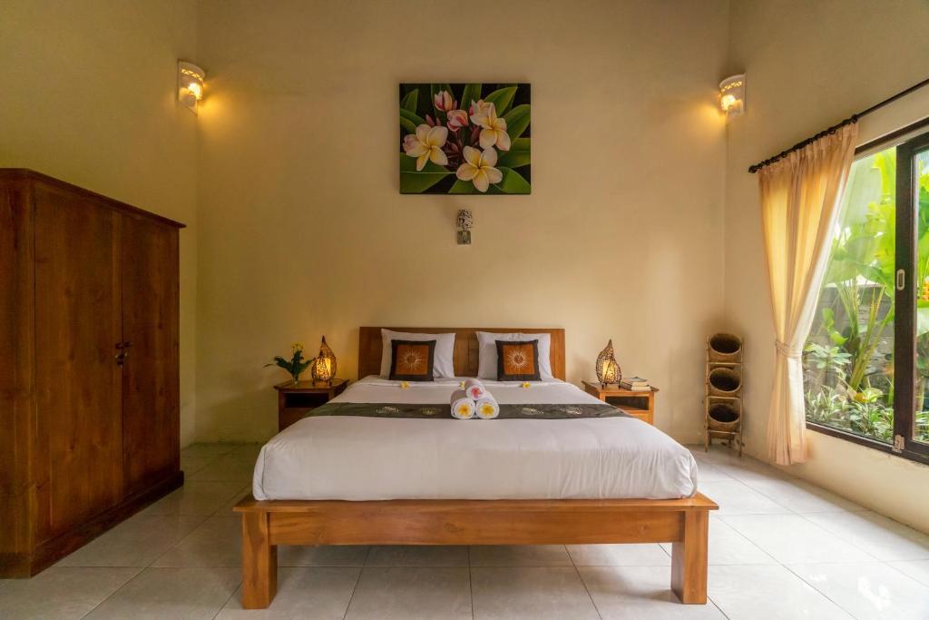 Cama o camas de una habitación en Rumah Surga Villa