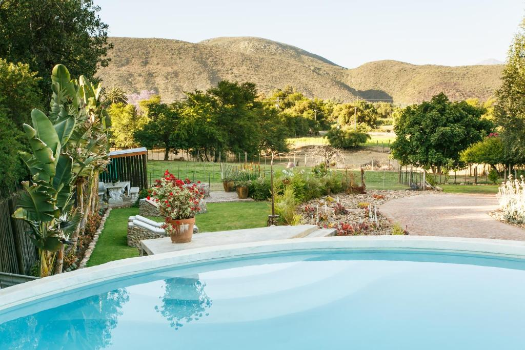 The swimming pool at or near Die Fonteine Guest House