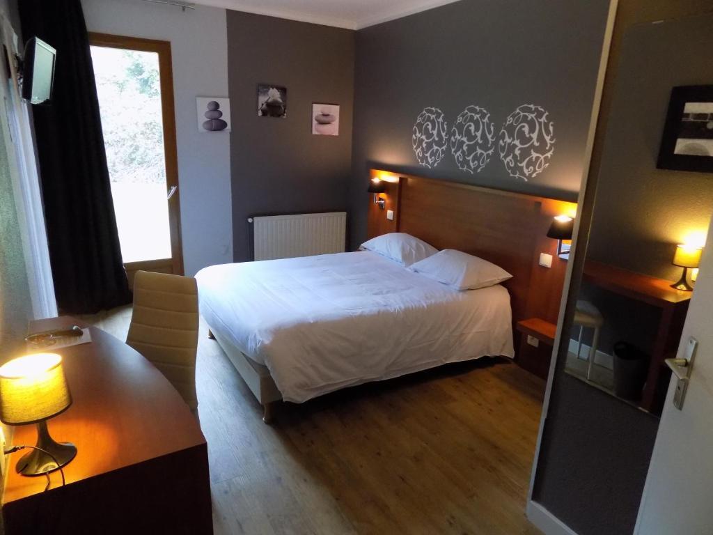 Un ou plusieurs lits dans un hébergement de l'établissement Hotel Martinez Grenay