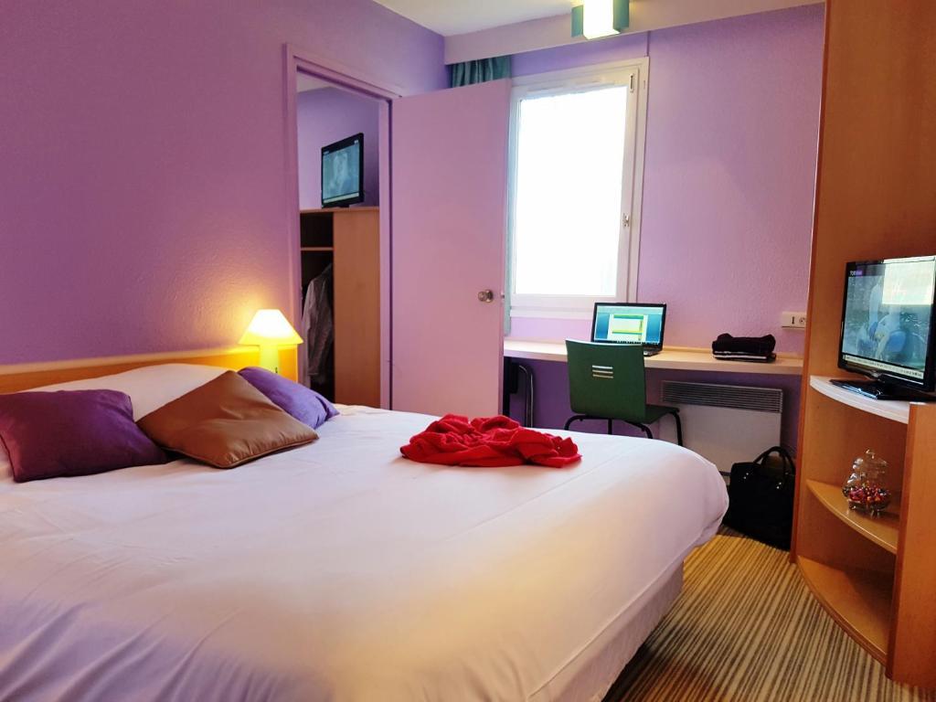Un ou plusieurs lits dans un hébergement de l'établissement Hotel Bonanite