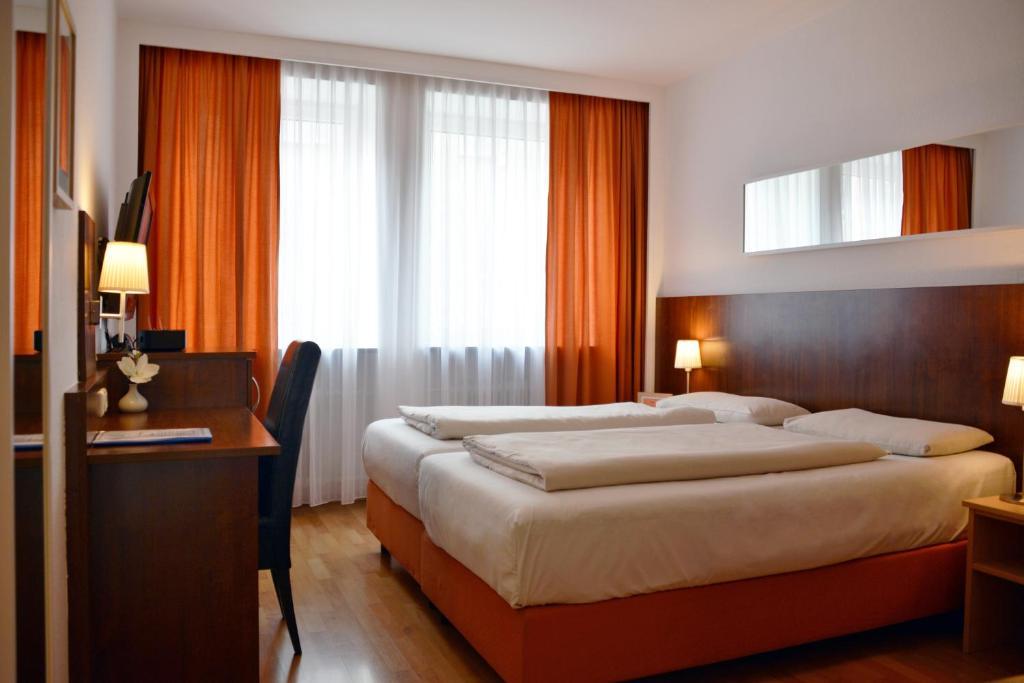 Ein Bett oder Betten in einem Zimmer der Unterkunft Hotel Italia