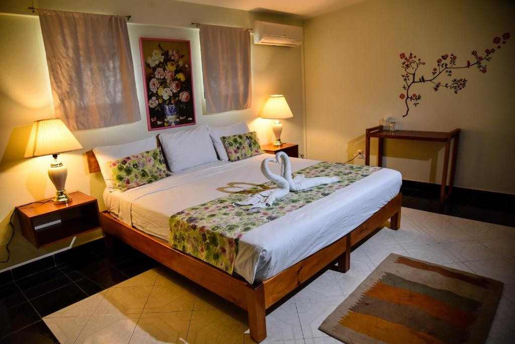 A bed or beds in a room at Hotel Akumal