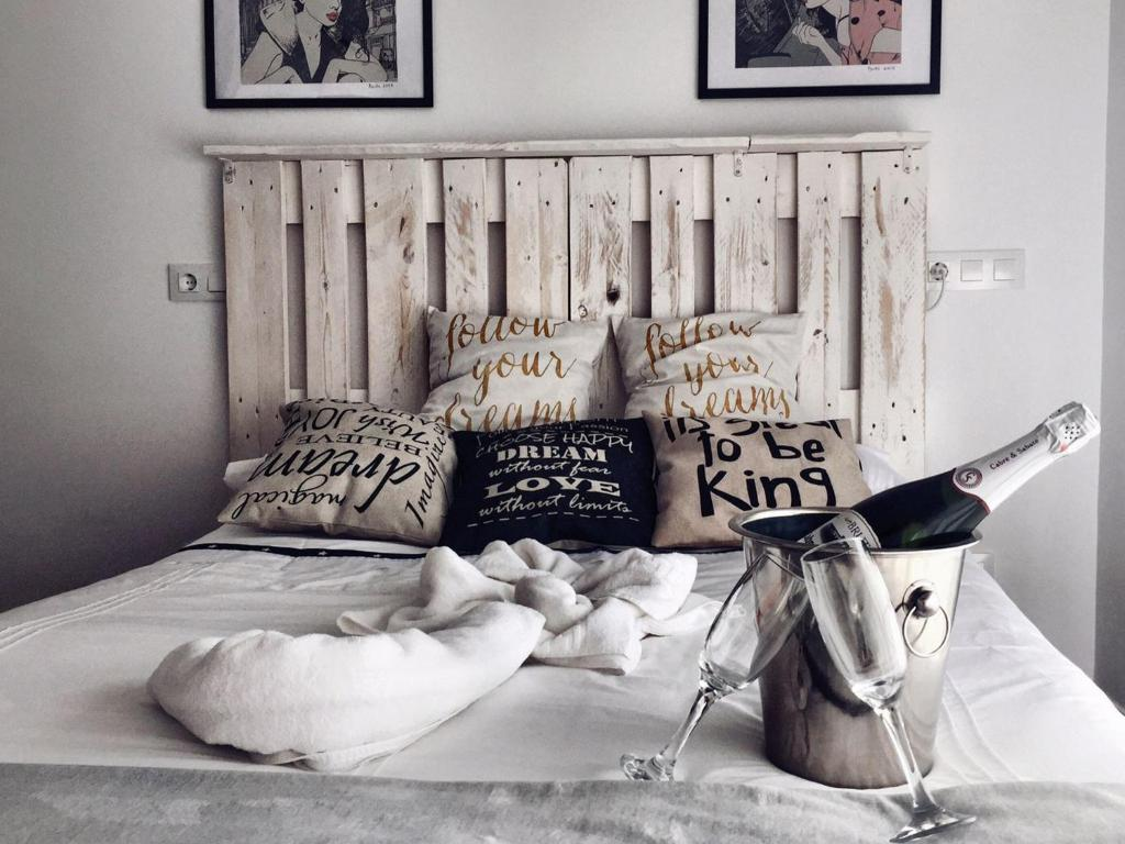 Cama o camas de una habitación en Hostal Ciempozuelos