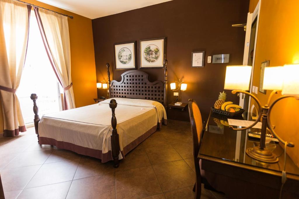 Een bed of bedden in een kamer bij Hotel dei Coloniali