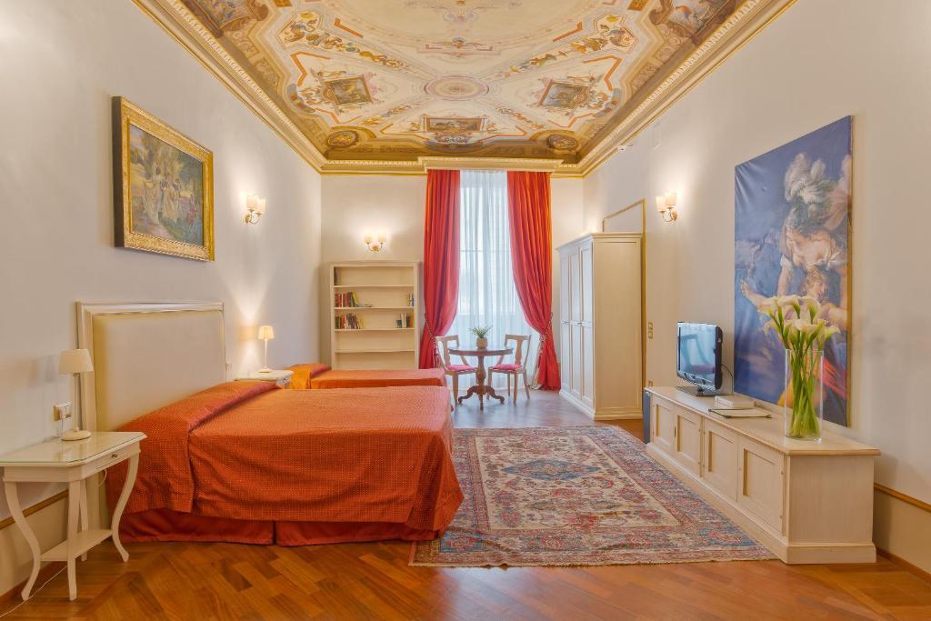 Gulta vai gultas numurā naktsmītnē Hotel Dei Macchiaioli