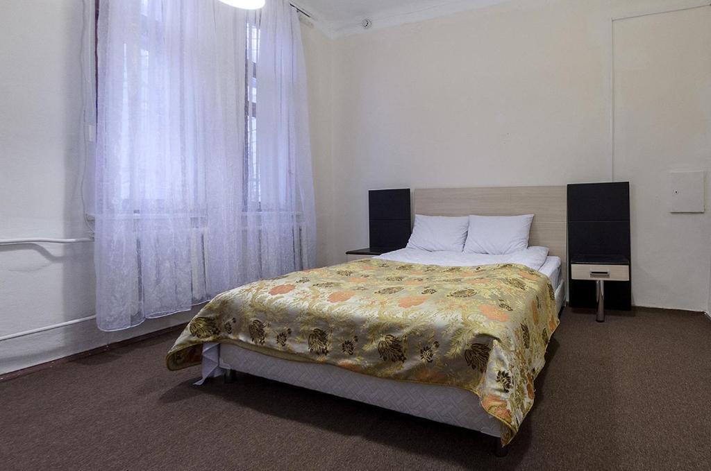 Кровать или кровати в номере Хостел Централь