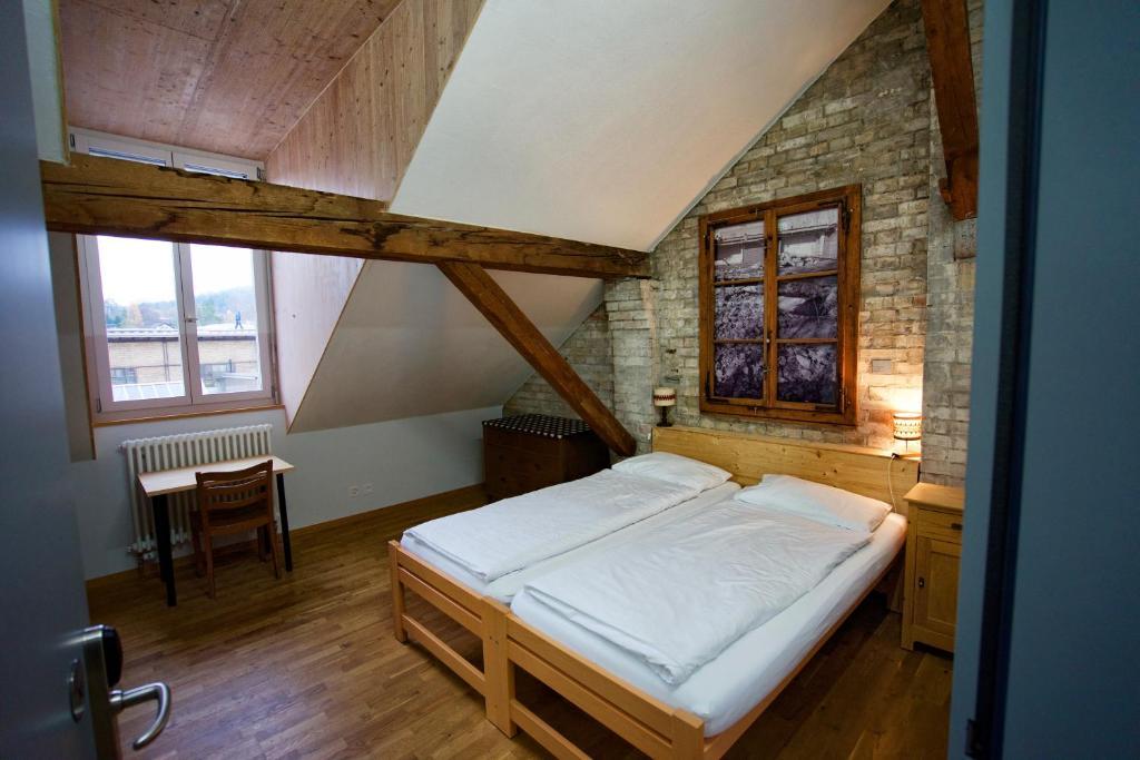 Ein Bett oder Betten in einem Zimmer der Unterkunft Depot 195 - Hostel Winterthur