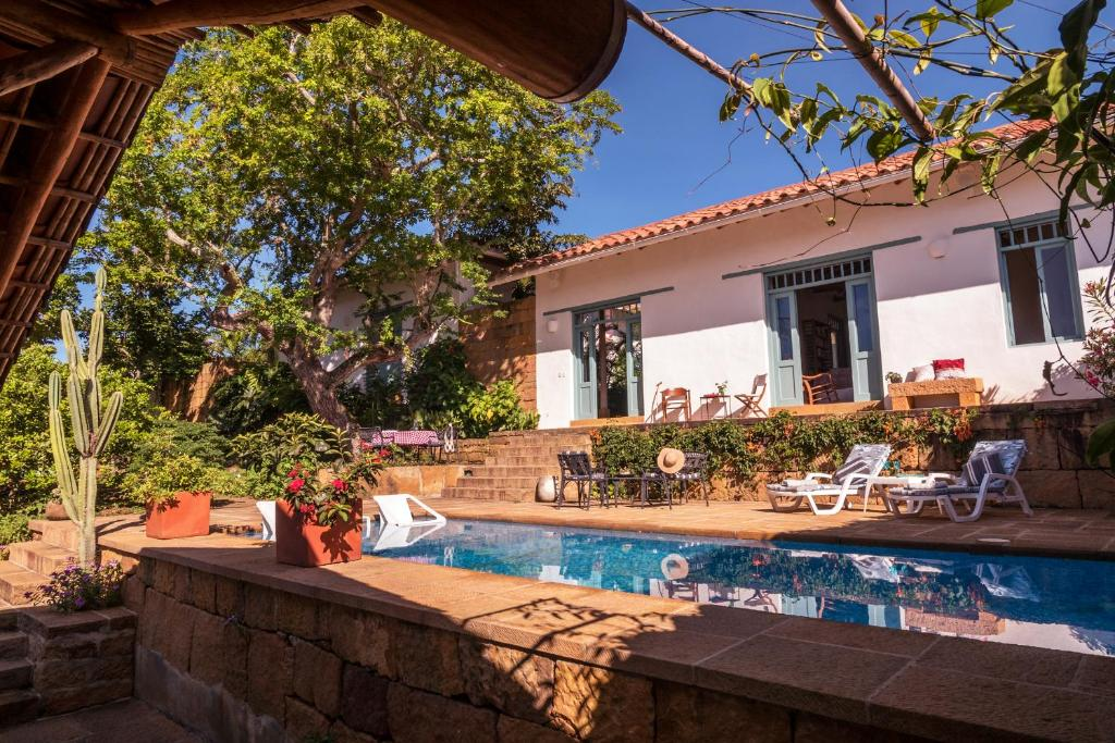 The swimming pool at or near Casa Barichara Boutique