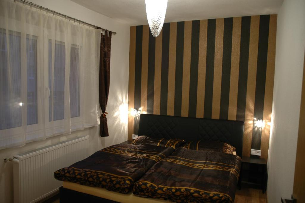 Postel nebo postele na pokoji v ubytování Apartment Villa Brezno