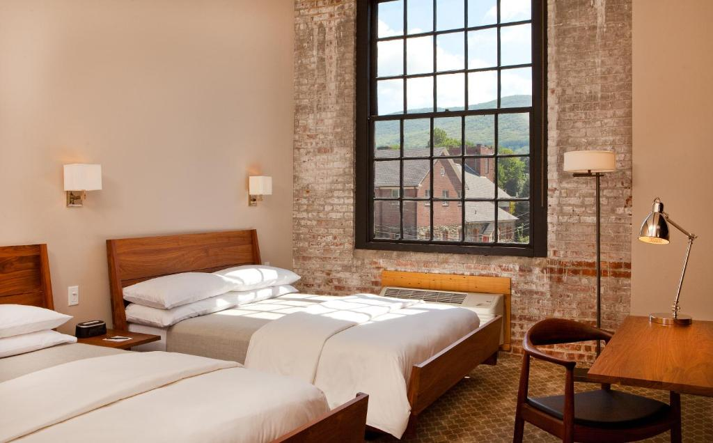 A bed or beds in a room at Roundhouse