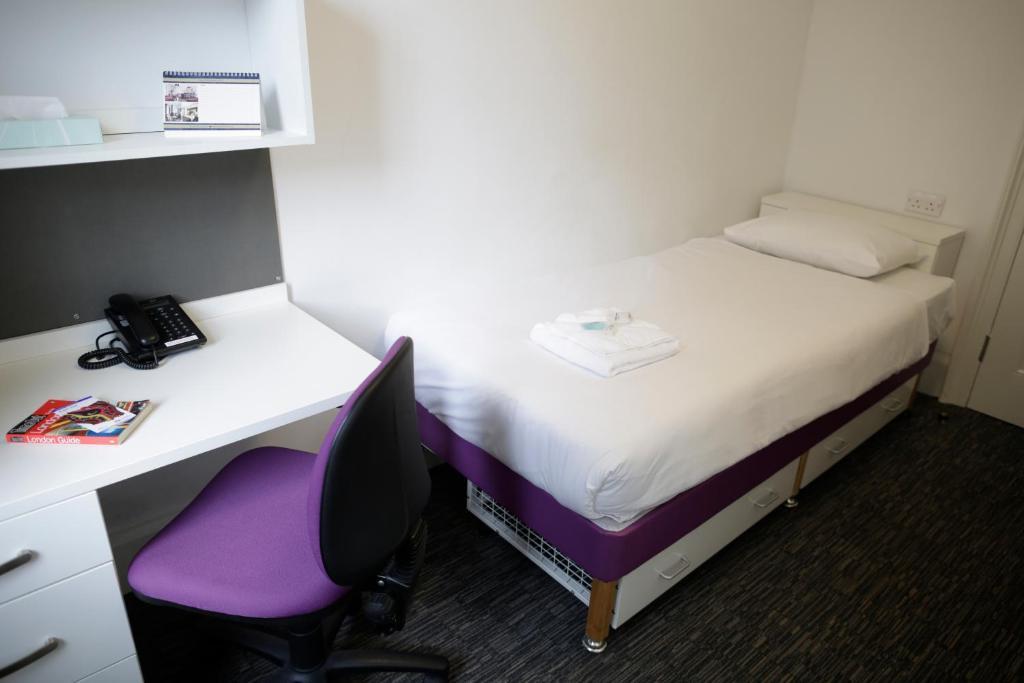 Ein Bett oder Betten in einem Zimmer der Unterkunft Wilson House