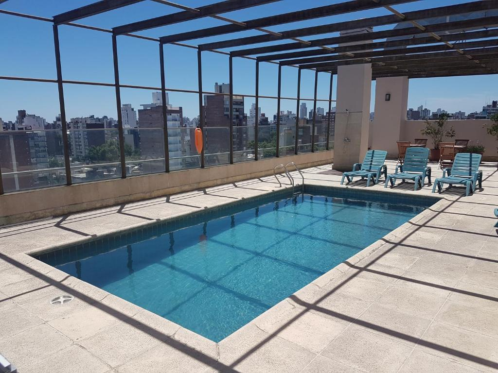 The swimming pool at or near Ariston Hotel