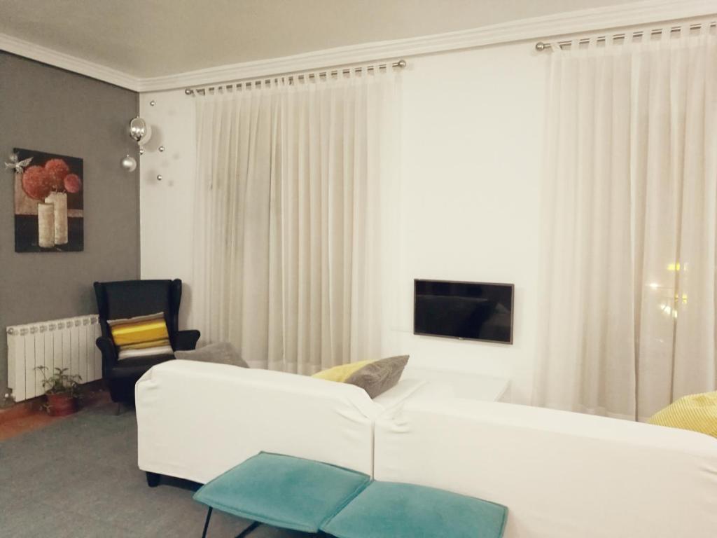 Postel nebo postele na pokoji v ubytování Hostal Terán