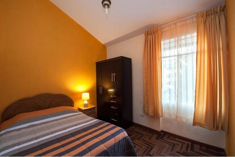Cama o camas de una habitación en Apartment Casa de Mama - Pachacutec