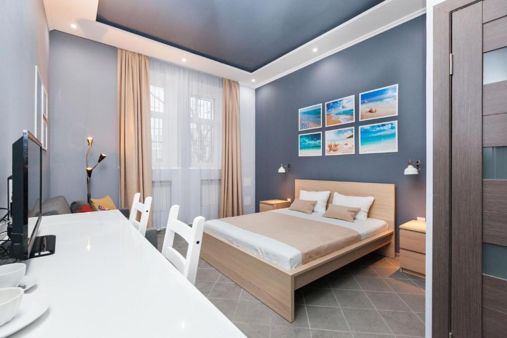 A bed or beds in a room at MiniHotel Brusnika na Khoroshevskom