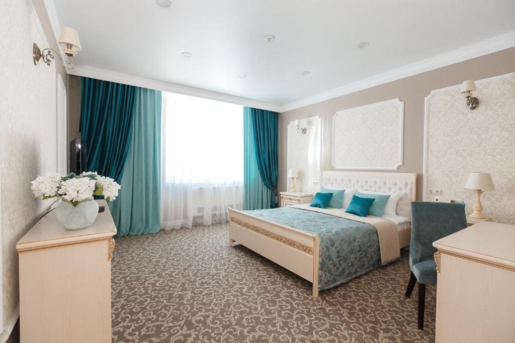 Кровать или кровати в номере Гостиница Сибирь МВДЦ