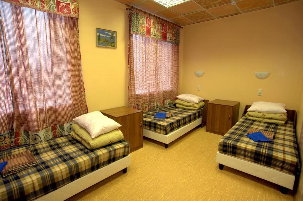Кровать или кровати в номере Хостел В Городе N
