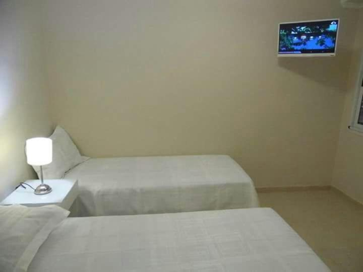 A bed or beds in a room at Hotel Di Sorrento