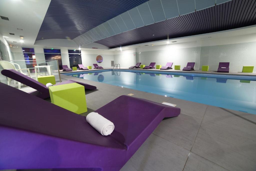 The swimming pool at or near Hotel Plaza - site du Futuroscope