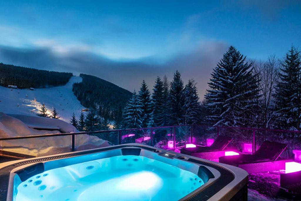 The swimming pool at or near Pytloun Wellness Hotel Harrachov