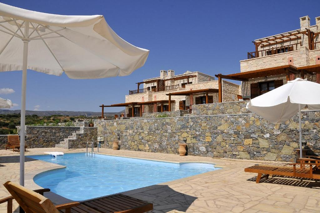 The swimming pool at or near Esperides Stone Houses