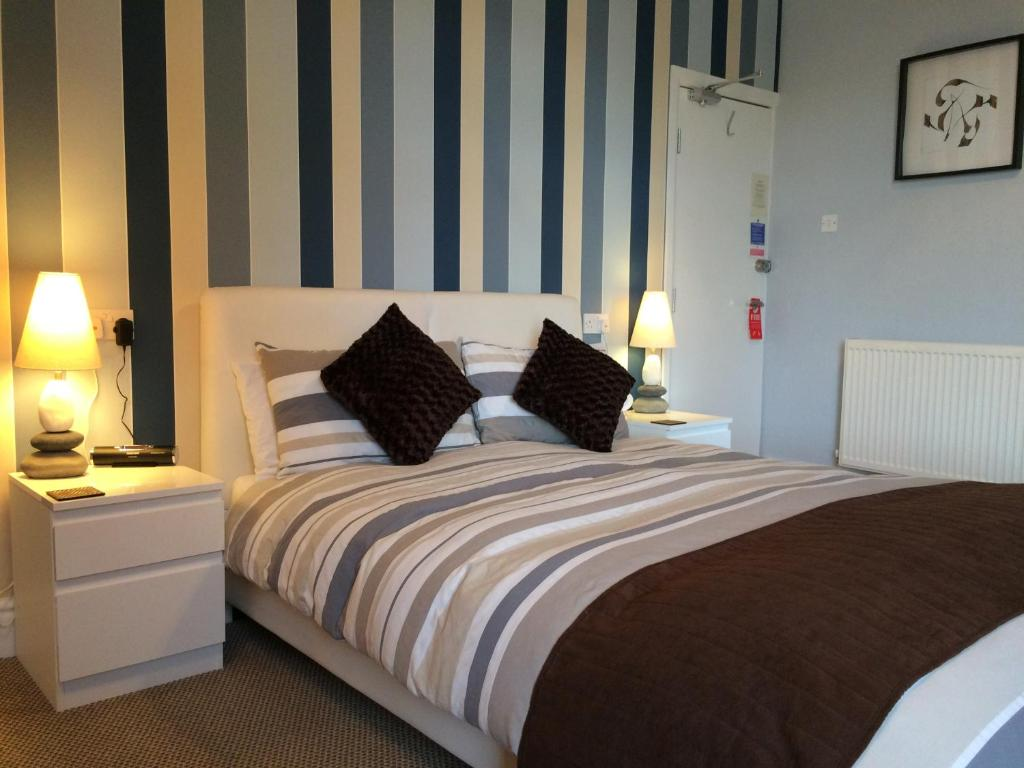 A bed or beds in a room at The Waterford