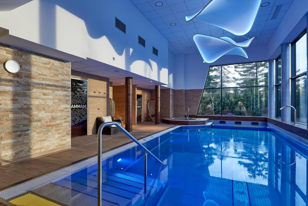 The swimming pool at or near Brit Airport Club Hotel - Basel Mulhouse