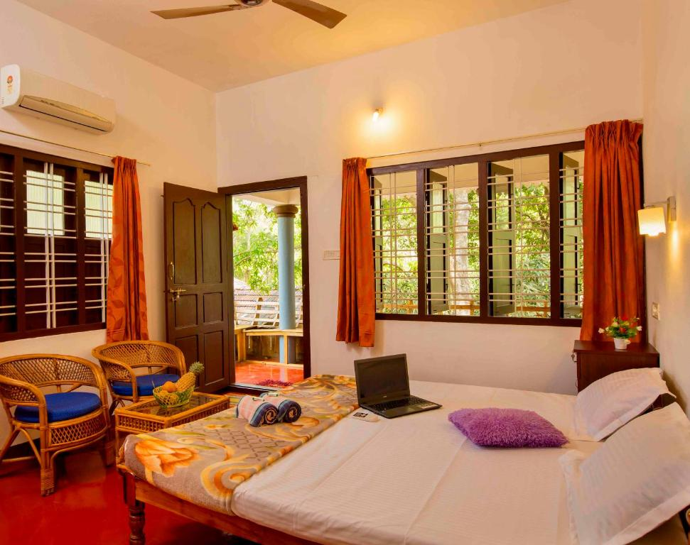 A bed or beds in a room at Raju Villa