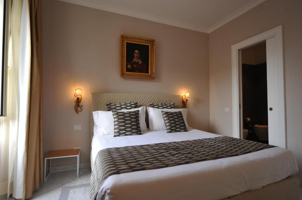 A bed or beds in a room at Angel Spagna Suite